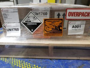 dg shipment overpack on skid with labeling